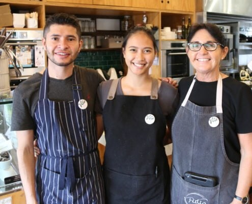 Countrywide Cafe of the Year Competition - staff Mike, Rica, Deb wearing badges